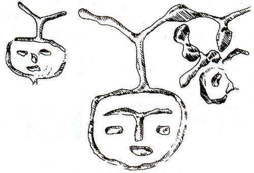 Hình mặt người khắc trên vách hang Đồng Nội – Hòa Bình